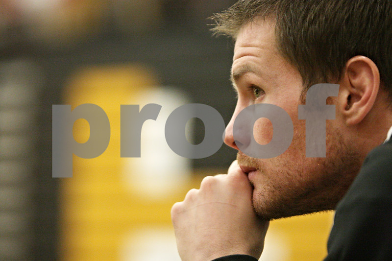 Rob Winner – rwinner@shawmedia.com<br /> <br /> Sycamore coach Alex Nelson watches as Dylan Foster competes against Morris' Drake Dryfhout in a 145-pound match during the Northern Illinois Big 12 Conference Tournament in Sycamore, Ill., Saturday, Jan. 19, 2013.