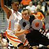 Rob Winner – rwinner@shawmedia.com<br /> <br /> Sycamore's Jacob Winters (right) moves the ball past DeKalb's Rudy Lopez during the second quarter at the Convocation Center in DeKalb, Ill., Friday, Jan. 25, 2013.