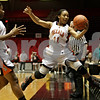 Rob Winner – rwinner@shawmedia.com<br /> <br /> DeKalb's Courtney Patrick (11) saves a ball from going out-of-bounds during the first quarter at the Convocation Center in DeKalb, Ill., Friday, Jan. 25, 2013.