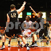 Kyle Bursaw — kbursaw@shawmedia.com<br /> <br /> DeKalb's Riccardo Pitts drives to the basket before making a pass between Sycamore defenders in the second quarter. DeKalb and Sycamore faced off in their annual game at the Convocation Center in DeKalb, Ill. on Friday, Jan. 25, 2013.