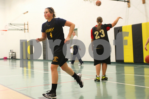 Kyle Bursaw – kbursaw@shawmedia.com<br /> <br /> Sycamore sophomore Bailey Gilbert hustles to the basket to recover her ball during a shooting drill at practice on Wednesday, Jan. 16, 2013.