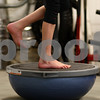Kyle Bursaw – kbursaw@shawmedia.com<br /> <br /> Janae Heegaard, 9, stands on one foot atop a balancing platform, one of her exercises to work on her stability at Moose (L)-Up in Sycamore, Ill. on Friday, Jan. 11, 2013. Doctors found a Wilms' tumor in Janae's kidney when she was five years old. As a result of the chemotherapy, one of Janae's kidneys was removed and she also developed neuropathy, which led to some stunted growth in her legs and Achilles tendon. Her parents were told that Janae would recover about 90 to 95% but would probably not be able to play on a competitive level in sports that required heavy use of the legs.