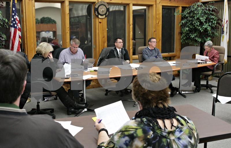 Rob Winner – rwinner@shawmedia.com<br /> <br /> DeKalb Park District board members during a meeting at Hopkins Park in DeKalb, Ill. on Wednesday, Jan. 16, 2013.