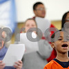Rob Winner – rwinner@shawmedia.com<br /> <br /> Youth choir member Donovan Hudson, 7, sings during practice at New Hope Missionary Baptist Church in DeKalb, Ill., Saturday, Jan. 19, 2013. The group will perform during a Martin Luther King Jr. Day celebration at the church on Monday evening.