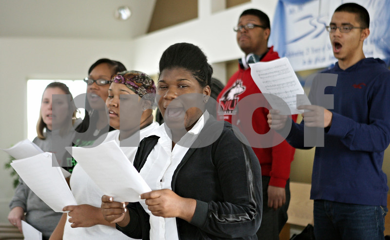Rob Winner – rwinner@shawmedia.com<br /> <br /> Community choir members. including Sade' Broger (front), of DeKalb, sing during practice at New Hope Missionary Baptist Church in DeKalb, Ill., Saturday, Jan. 19, 2013. The group will perform during a Martin Luther King Jr. Day celebration at the church on Monday evening.
