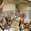 Rob Winner – rwinner@shawmedia.com<br /> <br /> Kaneland's Drew David (4) drives to the basket during the first quarter in Maple Park, Ill., Tuesday, Jan. 22, 2013. Kaneland defeated Sycamore, 43-42.