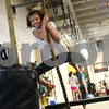 Kyle Bursaw – kbursaw@shawmedia.com<br /> <br /> Janae Heegaard swings on a rope to knock down a punching bag with her feet at Moose (L)-Up in Sycamore, Ill. on Friday, Jan. 11, 2013. Janae recently started going to Moose (L)-Up with her whole family, she works on her stability exercises and then has some time to climb on other equipment while the rest of her family also works out and with the trainers. Doctors found a Wilms' tumor in Janae's kidney when she was five years old. As a result of the chemotherapy, one of Janae's kidneys was removed and she also developed neuropathy, which led to some stunted growth in her legs and Achilles tendon. Her parents were told that Janae would recover about 90 to 95% but would probably not be able to play on a competitive level in sports that required heavy use of the legs.