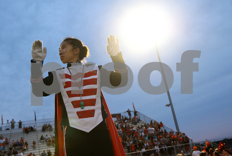Kyle Bursaw – kbursaw@shawmedia.com<br /> <br /> DeKalb drum major Theresa Nguyen conducts the marching band's pre-game show at DeKalb High School on Friday, Aug. 31, 2012.