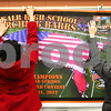 Kyle Bursaw – kbursaw@shawmedia.com<br /> <br /> Suzy Changnon and Jen Conley, mothers of clarinet player Ben Changnon and alto sax player Nelle Conley, hang up a banner on Thursday, Jan. 3, 2013 showing the DeKalb High School marching band competing in New Orleans on December 31.