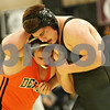 Rob Winner – rwinner@shawmedia.com<br /> <br /> DeKalb's Alex Roach (left) competes against Sycamore's Martin Malone during the 220-pound match in Sycamore, Ill., Thursday, Jan. 10, 2013. Malone won with a 3-2 decision.