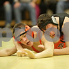 Rob Winner – rwinner@shawmedia.com<br /> <br /> DeKalb's Brenden McGee (left) is controlled by Sycamore's Kyle Akins during the 113-pound match in Sycamore, Ill., Thursday, Jan. 10, 2013. Akins won with a technical fall.
