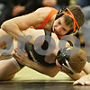 Rob Winner – rwinner@shawmedia.com<br /> <br /> DeKalb's Parker Stratton (top) controls Sycamore's Bryce Hansen during their 106-pound match in Sycamore, Ill., Thursday, Jan. 10, 2013. Stratton would eventually pin Hansen.