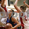 Rob Winner – rwinner@shawmedia.com<br /> <br /> Genoa-Kingston's Andrea Strohmaier (center) tries to maneuver past two Indian Creek defenders during the third quarter in Shabbona, Ill., Saturday, Jan. 5, 2013. IC defeated GK, 39-26.