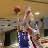 Rob Winner – rwinner@shawmedia.com<br /> <br /> Genoa-Kingston's Tommy Lucca (3) puts up a shot good for two points over Indian Creek's Garrison Govig (55) during the third quarter in Shabbona, Ill., Saturday, Jan. 5, 2013. GK defeated IC, 44-42.