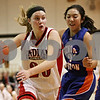 Rob Winner – rwinner@shawmedia.com<br /> <br /> Indian Creek's Kate Thuestad (20) moves the ball around Genoa-Kingston defender Katie Thurlby (21) during the second quarter in Shabbona, Ill., Saturday, Jan. 5, 2013. IC defeated GK, 39-26.