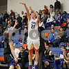 Rob Winner – rwinner@shawmedia.com<br /> <br /> Genoa-Kingston's Drew Anderson (21) puts up three points with a field goal during the second quarter in Genoa, Ill., Tuesday, Jan. 8, 2013. Hinckley-Big Rock defeated G-K, 51-40.
