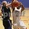 Rob Winner – rwinner@shawmedia.com<br /> <br /> Hinckley-Big Rock's Jared Madden (left) blocks a shot by Genoa-Kingston's Gabe Williams-Torres (33) during the third quarter in Genoa, Ill., Tuesday, Jan. 8, 2013. H-BR defeated G-K, 51-40.