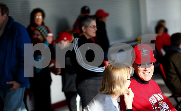 Kyle Bursaw – kbursaw@shawmedia.com<br /> <br /> Long-time NIU season ticket holders and Hampshire residents Renee and Larry Brodersen chat inside the Convocation Center while waiting to welcome back the Huskies to DeKalb on Wednesday, Jan. 2, 2013 after returning from their Orange Bowl loss in Miami.