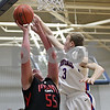 Rob Winner – rwinner@shawmedia.com<br /> <br /> Indian Creek's Garrison Govig (55) puts up a shot good for two points over Hinckley-Big Rock's Jared Madden during the second quarter in Hinckley, Ill., Tuesday, Jan. 15, 2013. H-BR defeated Indian Creek, 64-60.