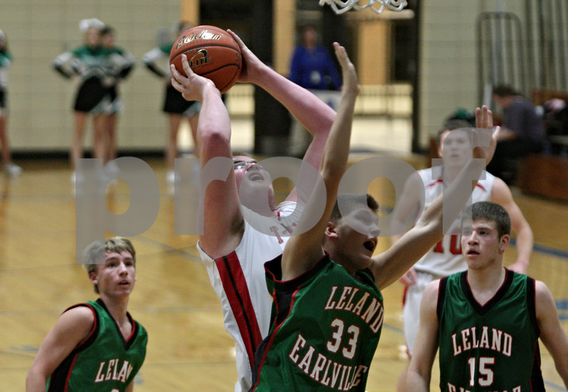 Rob Winner – rwinner@shawmedia.com<br /> <br /> Indian Creek's Garrison Govig (55) controls a rebound before putting up a shot for two points in the third quarter during a game against Leland-Earlville at the Little Ten Conference tournament in Somonauk, Ill., Monday, Jan. 28, 2013.