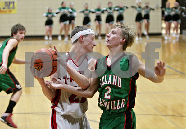 Rob Winner – rwinner@shawmedia.com<br /> <br /> Indian Creek's Tyler Reynolds (23) controls a defensive rebound ahead of Leland-Earlville's J.J. Clason (2) in the second quarter at the Little Ten Conference tournament in Somonauk, Ill., Monday, Jan. 28, 2013.