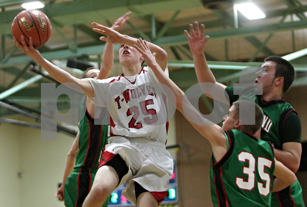 Rob Winner – rwinner@shawmedia.com<br /> <br /> Indian Creek's Noah Holm (25) drives past three Leland-Earlville defenders before putting up a shot good for two points during the first quarter at the Little Ten Conference tournament in Somonauk, Ill., Monday, Jan. 28, 2013.