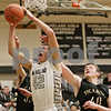 Rob Winner – rwinner@shawmedia.com<br /> <br /> Kaneland's Matt Limbrunner (42) tries to get a shot off during the third quarter in Maple Park, Ill., Tuesday, Jan. 22, 2013. Kaneland defeated Sycamore, 43-42.
