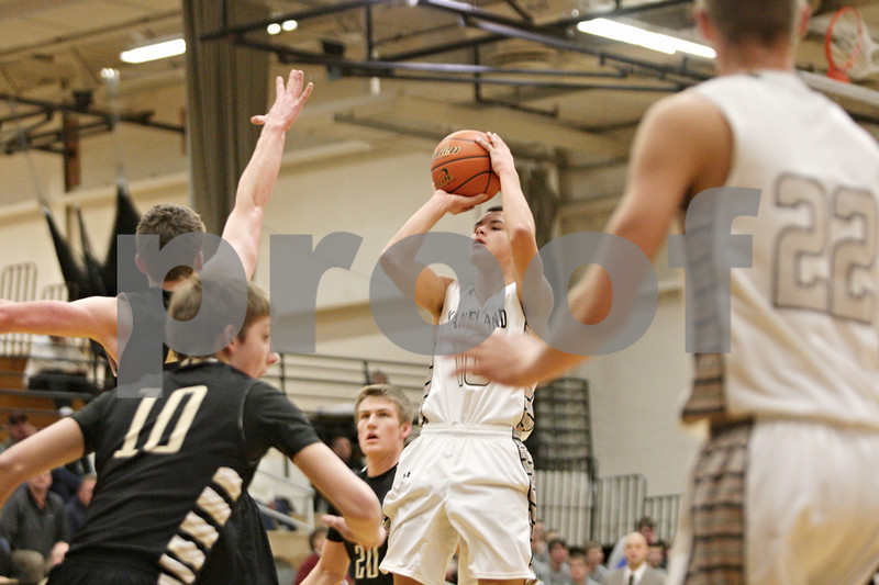 Rob Winner – rwinner@shawmedia.com<br /> <br /> Kaneland's Tyler Carlson (center) puts up a shot during the first quarter in Maple Park, Ill., Tuesday, Jan. 22, 2013. Kaneland defeated Sycamore, 43-42.