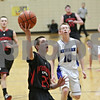 Rob Winner – rwinner@shawmedia.com<br /> <br /> Indian Creek's Noah Holm (25) goes to the basket in the first quarter during the Little Ten Conference tournament against Newark in Somonauk, Ill., Thursday, Jan. 31, 2013. Indian Creek defeated Newark, 58-57, in overtime.