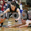 Rob Winner – rwinner@shawmedia.com<br /> <br /> Indian Creek's Kyle Lieving (left) looks to control a loose ball late in the fourth quarter during the Little Ten Conference tournament against Newark in Somonauk, Ill., Thursday, Jan. 31, 2013. Indian Creek defeated Newark, 58-57, in overtime.
