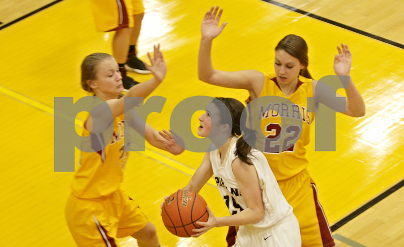 Rob Winner – rwinner@shawmedia.com<br /> <br /> Sycamore's Lauren Goff (15) goes to the basket in the second quarter against Morris in Sycamore, Ill., Friday, Jan. 4, 2013. Sycamore defeated Morris, 67-47.
