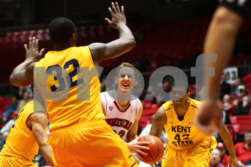 Kyle Bursaw – kbursaw@shawmedia.com<br /> <br /> Northern Illinois' Aksel Bolin moves into position to shoot while Kent State forward Melvin Tabb (32) puts up his hands in the first half at the Convocation Center in DeKalb, Ill. on Wednesday, Jan. 30, 2013.