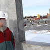 Kyle Bursaw – kbursaw@shawmedia.com<br /> <br /> T. J. Moore, DeKalb's director of public works, looks out at Lincoln Highway from the roof of the new DeKalb police station on Monday, Jan. 14, 2013. The station is on track to open in late 2013.