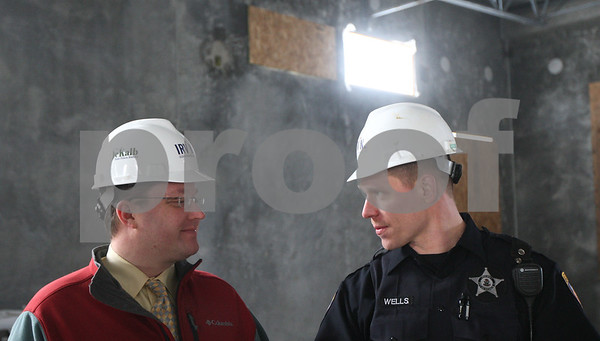 Kyle Bursaw – kbursaw@shawmedia.com<br /> <br /> T. J. Moore, DeKalb's director of public works, talks with DeKalb police officer Todd Wells on Monday, Jan. 14, 2013 on the second floor of the new police station, which is still under construction and looking to open in late 2013.