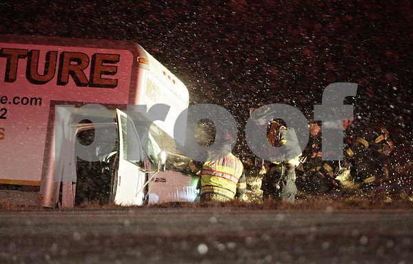 Rob Winner – rwinner@shawmedia.com<br /> <br /> Firefighters are seen near a box truck that was involved in an accident near the intersection of Route 23 and Lloyd Road south of Genoa on Wednesday, Jan. 23, 2013.