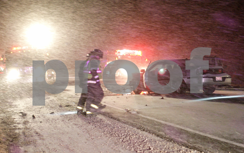 Rob Winner – rwinner@shawmedia.com<br /> <br /> Two firefighters are seen while inspecting vehicles that were involved in an accident near the intersection of Route 23 and Lloyd Road south of Genoa on Wednesday, Jan. 23, 2013.