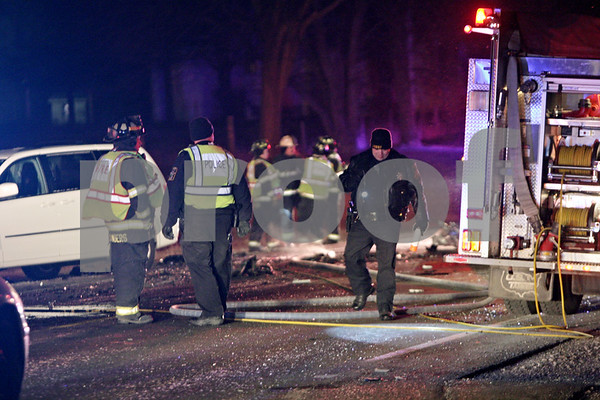Rob Winner – rwinner@shawmedia.com<br /> <br /> Emergency personnel respond to an accident near the intersection of Route 23 and Lloyd Road south of Genoa on Wednesday, Jan. 23, 2013.