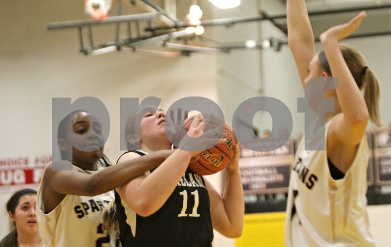 Rob Winner – rwinner@shawmedia.com<br /> <br /> Sycamore's Taiya Hopkins (left) fouls Kaneland's Ashley Prost (11) during the second quarter in Sycamore, Ill., Friday, Jan. 18, 2013. Sycamore defeated Kaneland in overtime, 49-48.