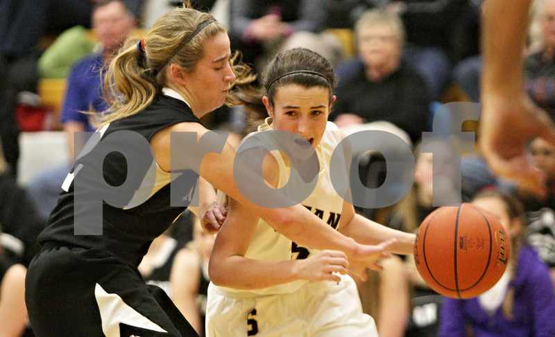 Rob Winner – rwinner@shawmedia.com<br /> <br /> Kaneland's Sarah Grams (left) reaches for a ball controlled by Sycamore's Lauren Goff during the first quarter in Sycamore, Ill., Friday, Jan. 18, 2013. Sycamore defeated Kaneland in overtime, 49-48.