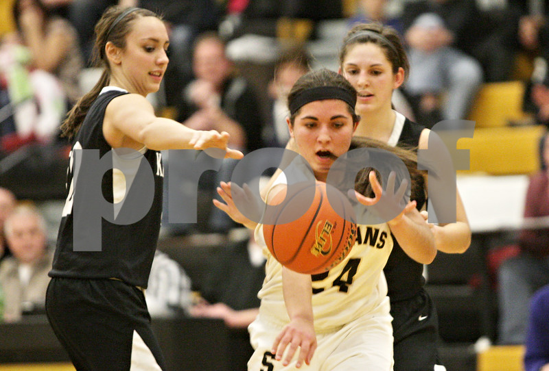 Rob Winner – rwinner@shawmedia.com<br /> <br /> Sycamore's Julia Moll (24) controls a ball after struggling with Kaneland's Emma Bradford (left) and Brooke Harner during overtime in Sycamore, Ill., Friday, Jan. 18, 2013. Sycamore defeated Kaneland, 49-48.