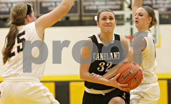 Rob Winner – rwinner@shawmedia.com<br /> <br /> Kaneland's Emma Bradford (32) drives to the basket before a shot good for two points during the second quarter in Sycamore, Ill., Friday, Jan. 18, 2013. Sycamore defeated Kaneland in overtime, 49-48.
