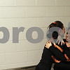 Kyle Bursaw — kbursaw@shawmedia.com<br /> <br /> DeKalb seniors Jaylene Thompson (let) and Hannah Hart, embrace in the hallway of the Convocation Center after performing for the last time at the annual game against Sycamore as DeKalb students on Friday, Jan. 25, 2013.