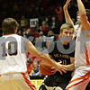 Rob Winner – rwinner@shawmedia.com<br /> <br /> Sycamore's Ben Niemann (20) drives to the basket before putting up two points during the fourth quarter at the Convocation Center in DeKalb, Ill., Friday, Jan. 25, 2013.