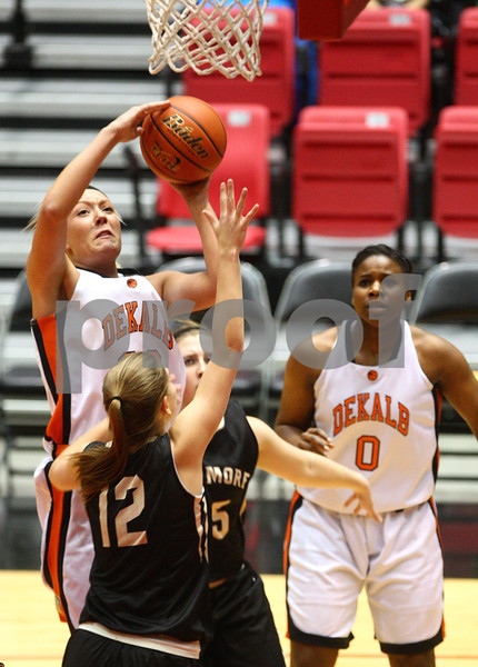 Kyle Bursaw — kbursaw@shawmedia.com<br /> <br /> DeKalb's Madelyne Johnson puts up a shot in the first quarter of the game against Sycamore. DeKalb defeated Sycamore 36-18 in their annual game at the Convocation Center in DeKalb, Ill. on Friday, Jan. 25, 2013.