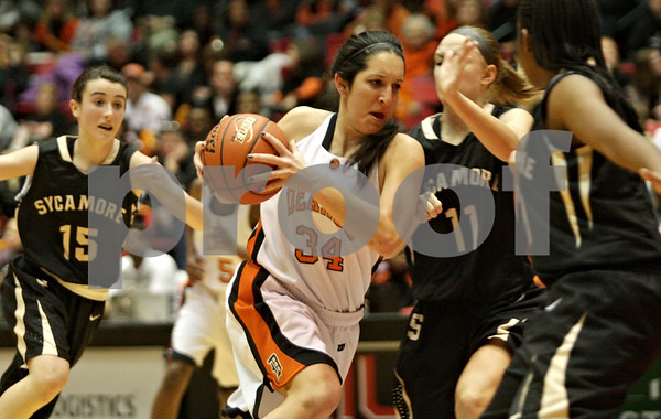 Rob Winner – rwinner@shawmedia.com<br /> <br /> DeKalb's Rachel Torres (34) drives to the basket during the third quarter at the Convocation Center in DeKalb, Ill., Friday, Jan. 25, 2013.