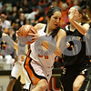 Rob Winner – rwinner@shawmedia.com<br /> <br /> DeKalb's Rachel Torres (34) drives to the basket during the third quarter at the Convocation Center in DeKalb, Ill., Friday, Jan. 25, 2013.