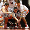 Kyle Bursaw — kbursaw@shawmedia.com<br /> <br /> DeKalb's Jake Carpenter (left) and Jake Smith (right) go for a loose ball along with Sycamore's Devin Mottet in the second quarter. DeKalb and Sycamore faced off in their annual game at the Convocation Center in DeKalb, Ill. on Friday, Jan. 25, 2013.