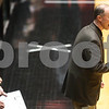 Kyle Bursaw — kbursaw@shawmedia.com<br /> <br /> Sycamore coach Brett Goff talks to his players in the second quarter of the game against DeKalb. DeKalb defeated Sycamore 36-18 in their annual game at the Convocation Center in DeKalb, Ill. on Friday, Jan. 25, 2013.
