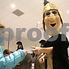 Rob Winner – rwinner@shawmedia.com<br /> <br /> Skyler Hayward (left), 9, gets an autograph from Mr. Spartan before the girls basketball game between DeKalb and Sycamore at the Convocation Center in DeKalb, Ill., Friday, Jan. 25, 2013.