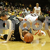 Rob Winner – rwinner@shawmedia.com<br /> <br /> Sycamore's Devin Mottet (15) knocks a ball away from DeKalb's Jake Carpenter during the first quarter at the Convocation Center in DeKalb, Ill., Friday, Jan. 25, 2013.
